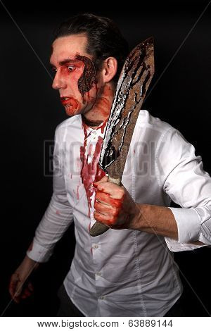 Psychopath with bloody knive in a white shirt stock photo