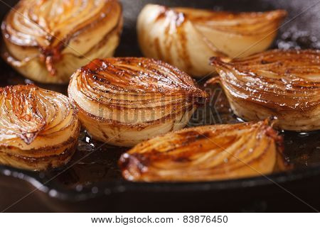 ?aramelized onion halves with balsamic vinegar in a pan close-up, horizontal stock photo