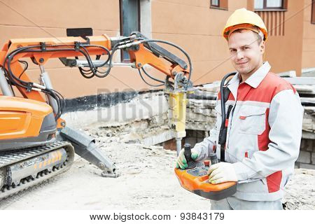 builder worker in safety protective equipment operating construction demolition machine robot stock photo