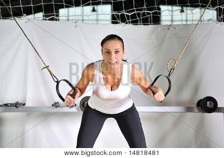 young woman practicing fitness and working out in a gym stock photo