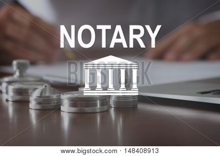 NOTARY. Metal ink pads and stamps on notary public table stock photo