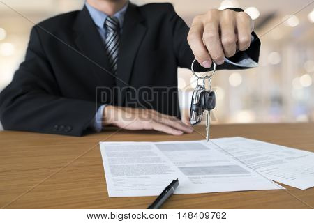 Business concept car insurance sell and buy car car financing car key for Vehicle Sales Agreement. stock photo