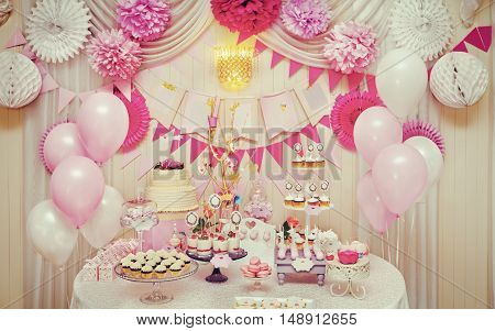 Delicious sweet buffet with cupcakes, meringues and other desserts. Creative instagram effect stock photo