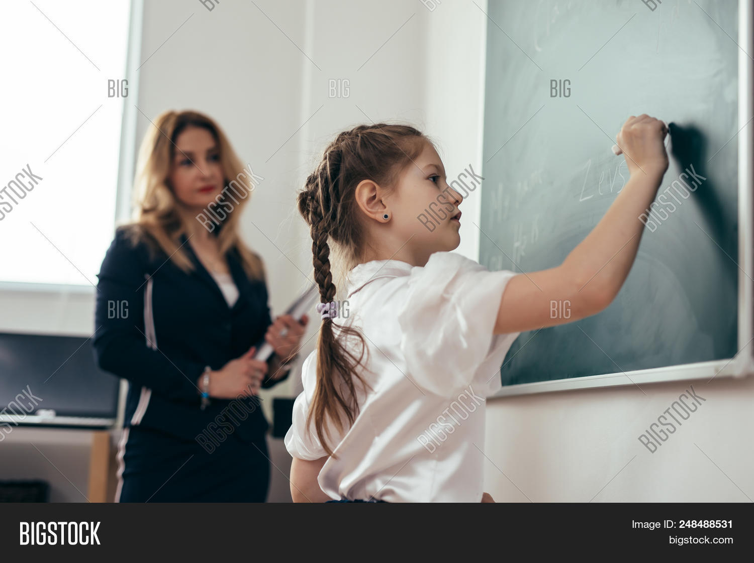apron,arithmetic,attentive,blackboard,board,caucasian,chalk,chalkboard,cheerful,child,class,classroom,clever,close,education,elementary,first-grader,girl,hand,italian,italianschoolgirl,junior,kid,learn,learning,lesson,little,mathematics,primary,pupil,recollect,room,school,schoolgirl,schooling,smiling,solve,standing,student,study,studying,task,teach,teacher,teaching,tutor,woman,work,writing,young
