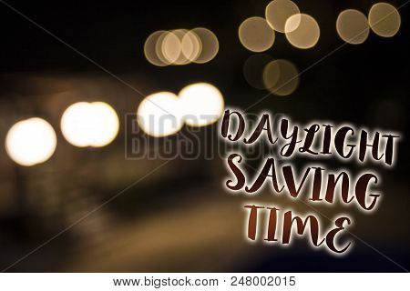 Conceptual hand writing showing Daylight Sayving Time. Business photo showcasing advancing clocks during summer to save electricity Nightlight enlighten reflection thoughts intentions memories stock photo