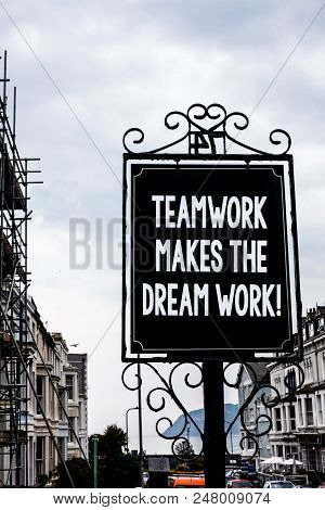 Handwriting text writing Teamwork Makes The Dream Work Call. Concept meaning Camaraderie helps achieve success Vintage black board white letters words cloudy background old city ideas stock photo