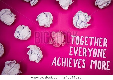 Conceptual hand writing showing Together Everyone Achieves More. Business photo text Teamwork Cooperation Attain Acquire Success Ideas pink background crumpled papers trial mistakes several tries stock photo