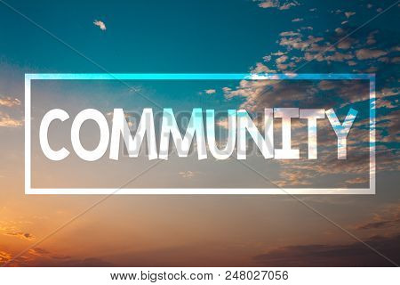 Handwriting text Community. Concept meaning Neighborhood Association State Affiliation Alliance Unity Group Sunset blue beach orange cloudy clouds sky ideas message natural relax stock photo