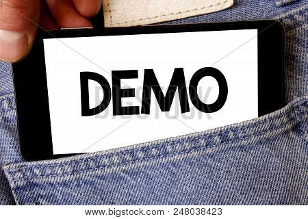 Handwriting text Demo. Concept meaning Trial Beta Version Free Test Sample Preview of something Prototype Man hold holding cell phone white screen message application technology stock photo