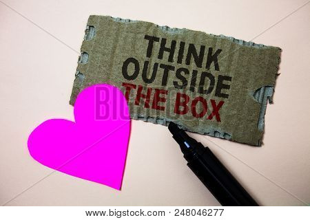 Text sign showing Think Outside The Box. Conceptual photo Thinking of new and creative solution leads to success Brown paperboard rough ideas message heart wild love lovely intentions stock photo