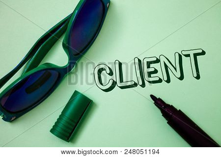 Writing note showing  Client. Business photo showcasing Purchaser Customer Shopper User Patron Prospect Sharer Investor Buyer Ideas messages white background open marker sunglasses communicate stock photo