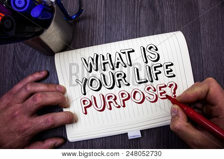 Conceptual hand writing showing What Is Your Life Purpose Question. Business photo showcasing Personal Determination Aims Achieve Goal Man hold holding red marker notebook table messages ideas stock photo