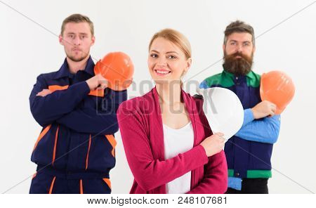 Team of builders concept. Builder, architect, engineer, labourer, repairman as friendly team. Team of architects, builders ready to work, isolated white background. Woman and men holds hard hats. stock photo