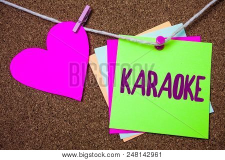 Word writing text Karaoke. Business concept for Entertainment singing along instrumental music played by a machine Heart thread sticky small cliped string thumb pin dark rough background stock photo