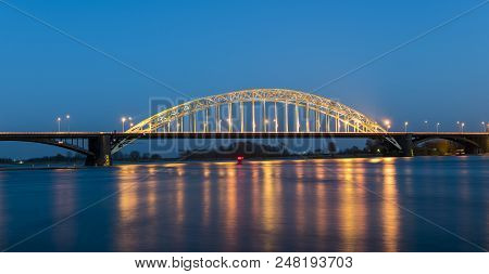 Waal bridge at Nijmegen at night with reflections. stock photo