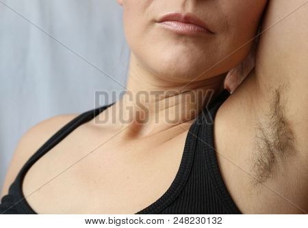 Woman with armpit hair, hair growth, depilation or new natural trend unshaved hair concept. stock photo