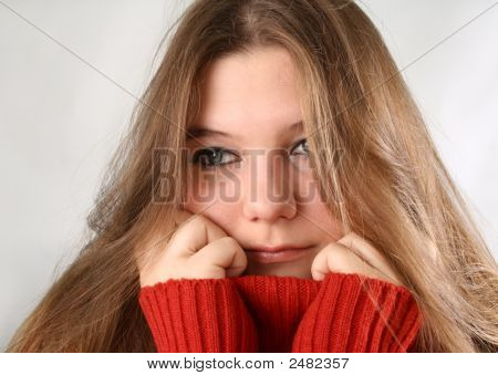 Portrait of a sad expression young woman with red pullover stock photo