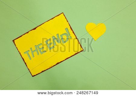 Writing note showing The End Motivational Call. Business photo showcasing Conclusion of time for something ending of life Nice lime colour grey shadow art paper lovely love hart romantic ideas stock photo