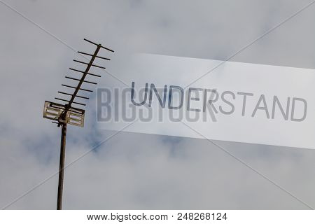 Writing note showing Understand. Business photo showcasing Ability to perceive intended meaning of something or someone Sky cloud cloudy grey gloomy tall big antenna nature rainy day weather stock photo