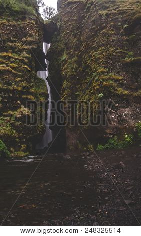 gljufrabui secret waterfall in iceland covered by rocks with moss water stock photo