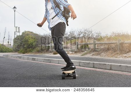 modern commute on electric skateboard in city urban transportation battery powered vehicle stock photo
