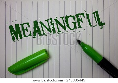 Handwriting text Meaningful. Concept meaning Having meaning Significant Relevant Important Purposeful Linned paper background pen cap marker highlighter ink green drawing stock photo
