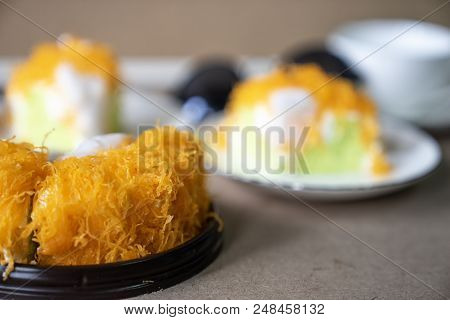 close up selective focus piece of  Gold Egg Yolk Thread Cake , or  'Cake Foi Tong