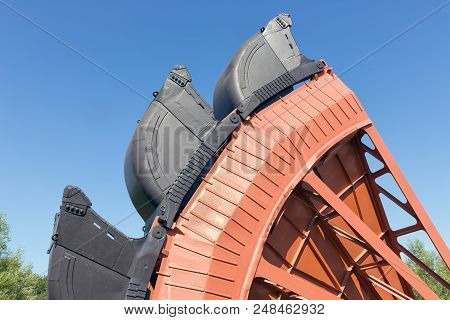 Exposition of bucket wheel at original size from digging excavator in open pit coal mines in Germany stock photo