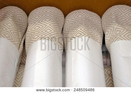 Folded grey cotton napkin isolated on wood table top view background stock photo