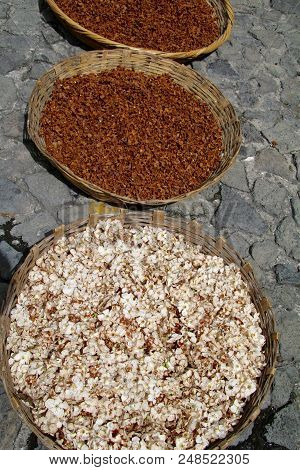 Incense used for Catholic processions in Guatemala, drying in huge baskets under the hot sun in a churchyard stock photo