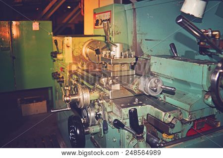 Lathe, metal processing by cutting on industrial equipment. Tinted image. stock photo
