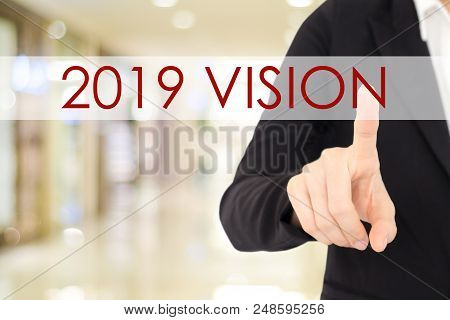 2019 vision banner, Businessman hand touching 2019 vision word over blur background, annual business plan, success in business concept stock photo