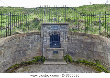 The remain of the ancient Well House located at the foothill of Holyrood Park in Edinburgh, Scotland, UK stock photo