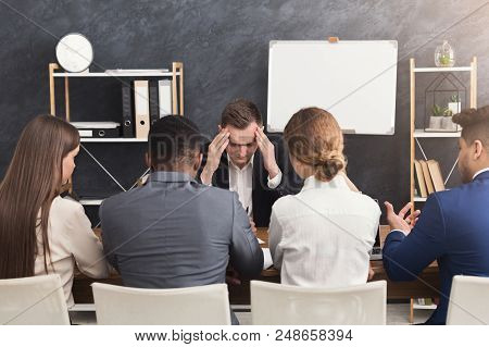 Nervous applicant at job interview being stressed, having headache. Stress resistance test for candidates, copy space stock photo