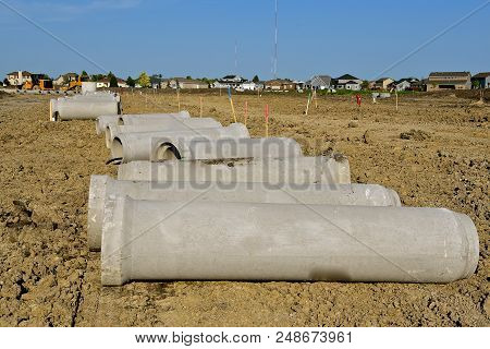 A new housing development is in the process as storm sewer pipe waits for the trenches to be excavated. stock photo
