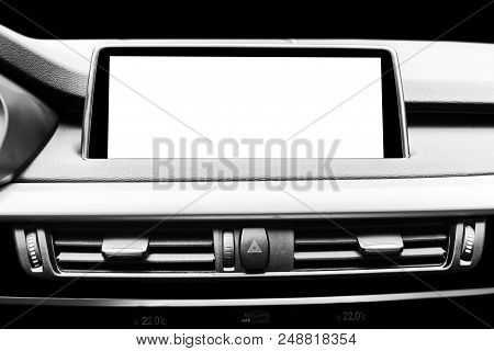 Monitor in car with isolated blank screen use for navigation maps and GPS. Isolated on white with clipping path. Car detailing. Modern car interior details. Black and white stock photo