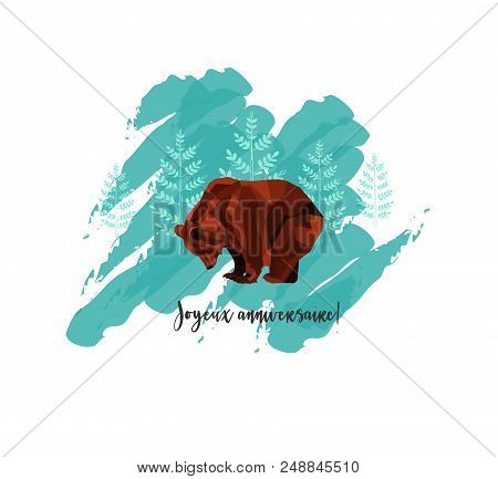 The Greeting Card with Low Poly Brown Bear and Trees on Background. Text in French: Joyeux Anniversaire - in English Happy Birthday. stock photo