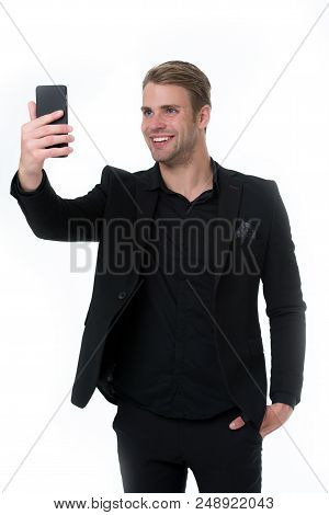 Happy to see you. Business man smartphone video conferencing isolated white. Businessman smiling face video call. Businessman black suit take advantages of video conferencing. Streaming video online. stock photo
