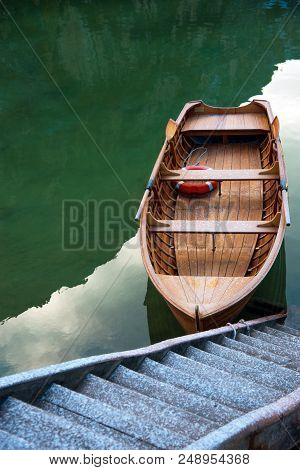 Mystic boat on Fanes-Sennes-Braies natural park in the Dolomites in South Tyrol, Alps, Italy (solitude, the way to the Lord, harmony, abandonment, seclusion, intimity, depression - concept) stock photo