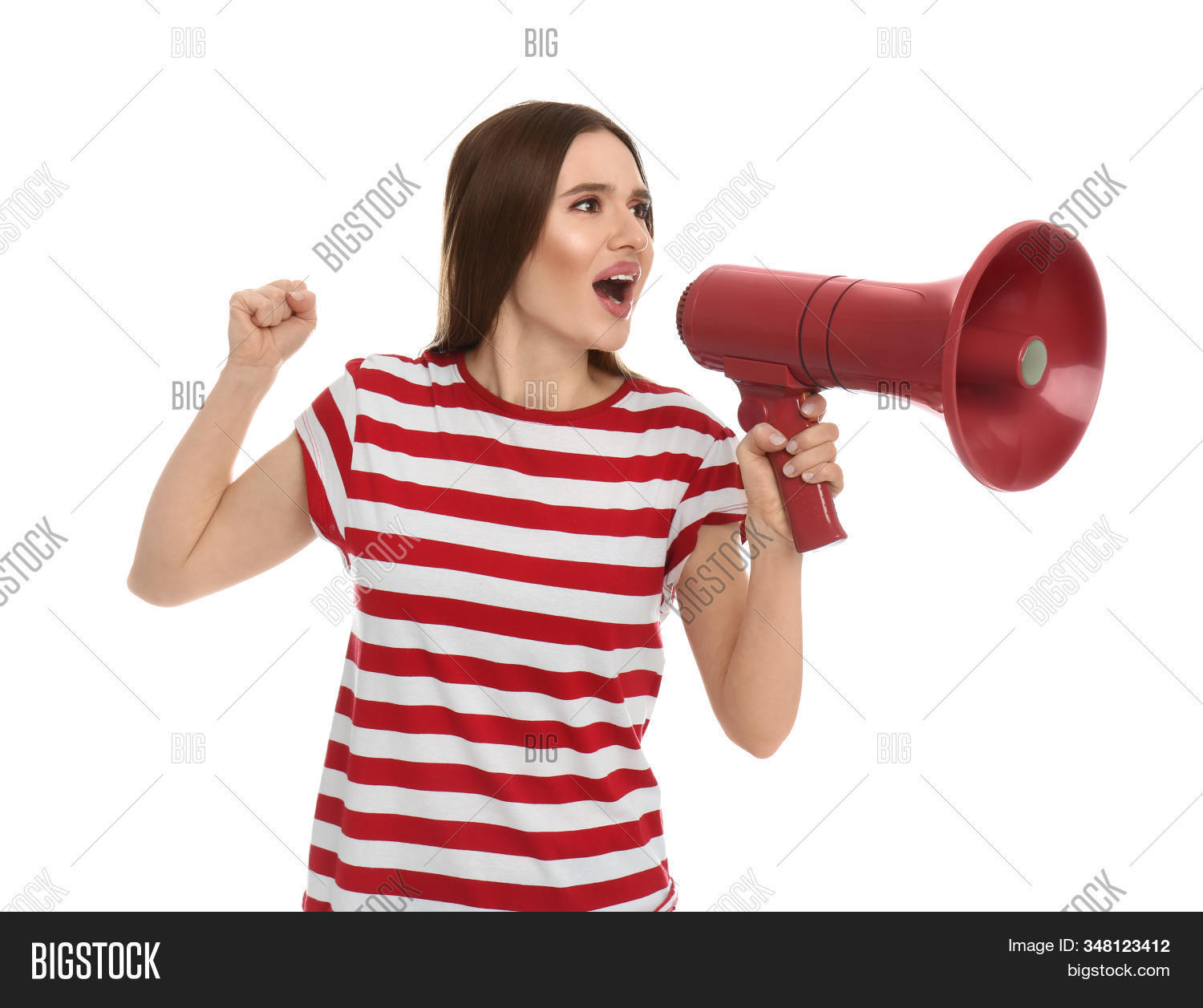 Young woman with megaphone on white background