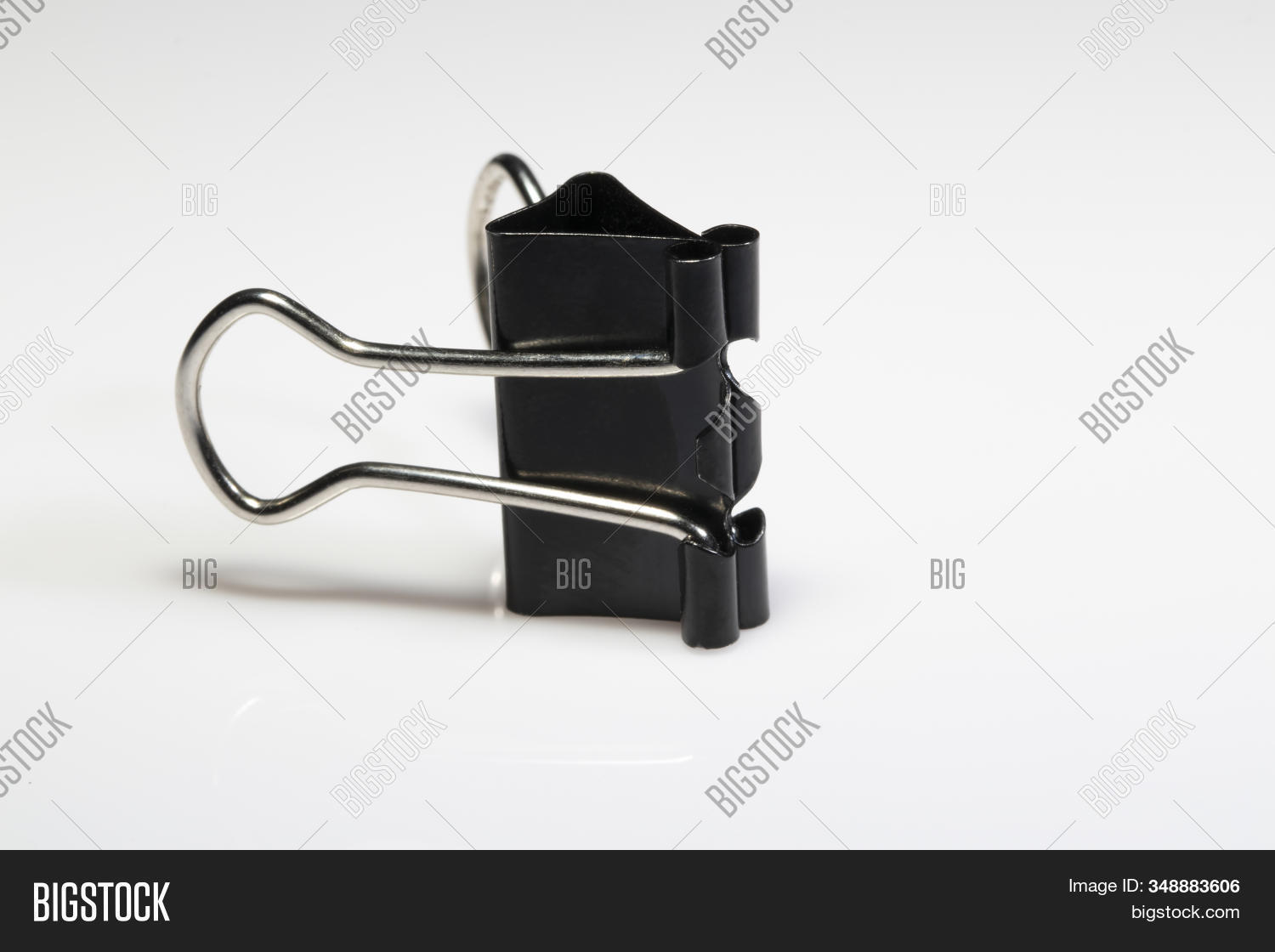 Close-Up metal Black Paper clip isolated on white background