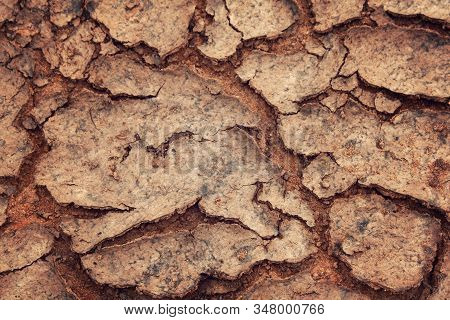 Cracks in the dried soil. Erosion. Global warming. Soil texture. Aged photo. Dry ground as a texture. Close Up of dry soil. stock photo