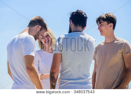 Cheerful people communicating. Networking concept. Spending time with friends. Summer vacation. Men woman communicating sky background. Communicative skills. Social interaction. Human communication stock photo