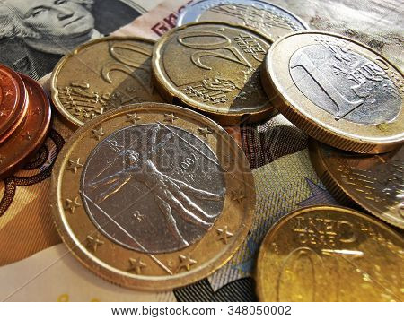 Euro coins and Euro cents. Paper notes of Euro, dollar and Russian rubles. Exchange rate. Buy currency sign. Exchange money. stock photo