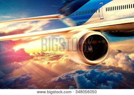 Concept of air travel and adventures background.Aeroplane and scenic sunset.Vacations and tourism flying around the world stock photo