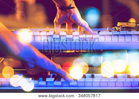 Live music and music festival background.Instrument on stage and band.Stage lights.Abstract musical background.Playing piano and concert concept. stock photo