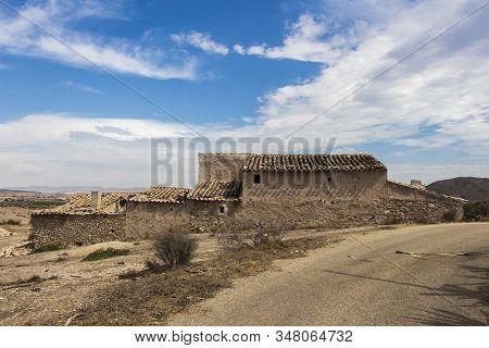 old stone farmhouse abandoned and in ruins, abandoned farmhouse on Huercal Overa, Almeria, Andalusia, Spain stock photo