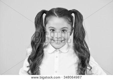 Homeschooling or visiting regular school. Efficiency of studying. Adorable schoolgirl. Emotional expression schoolgirl. Schoolgirl pupil long hair cute ponytails hairstyle. Educational program. stock photo
