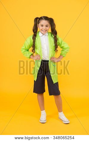 Waterproof concept. Small schoolgirl wear water resistant clothes. Cute schoolgirl feel protected. Happy schoolgirl wear raincoat. Invest in durable kids rainwear to keep children out in fresh air. stock photo