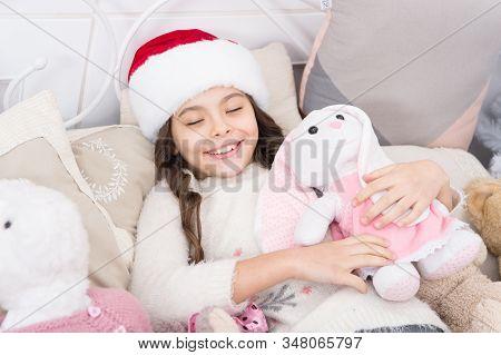 Her sleep is so sweet. Sleeping but beauty. Happy child smile in sleep. Little girl sleep on Christmas eve. Sleepy time. Bedtime. Keep calm. Good night. Sleep all night. stock photo